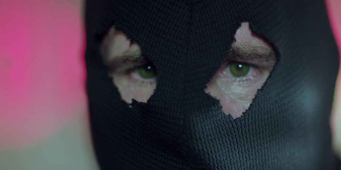 green-eyed man in the black hood riverdale