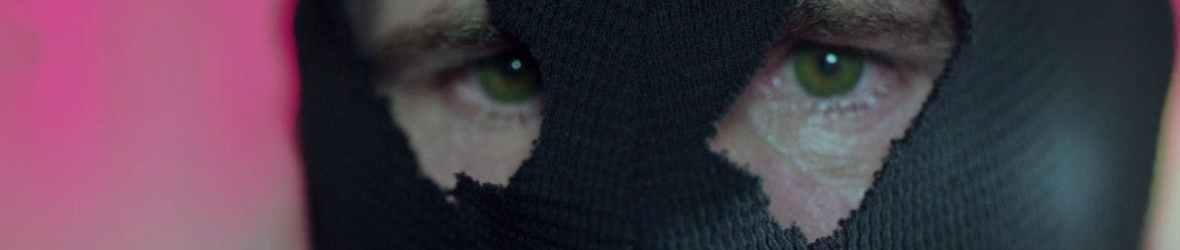green-eyed man in the black hood riverdale