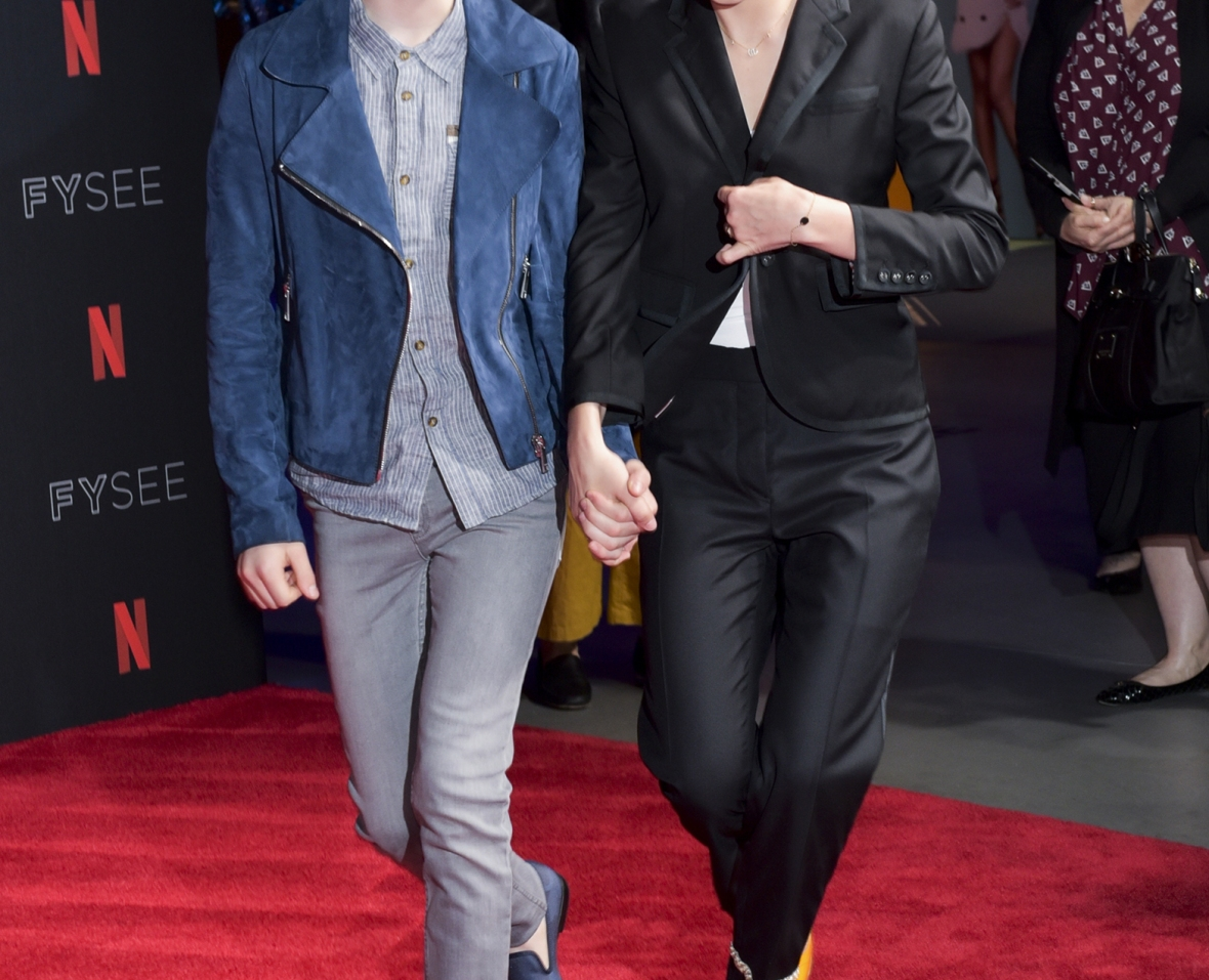 noah and millie holding hands