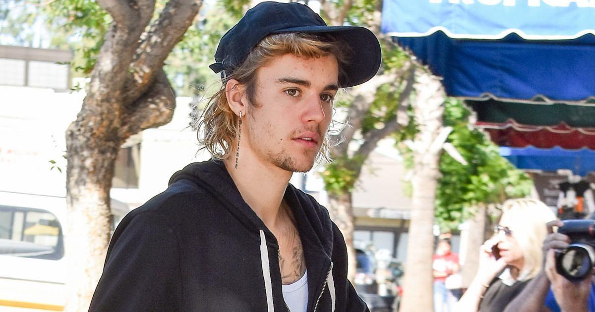 6963579653c Justin Bieber Face Tattoo: Singer Shows Off 'Grace' Design